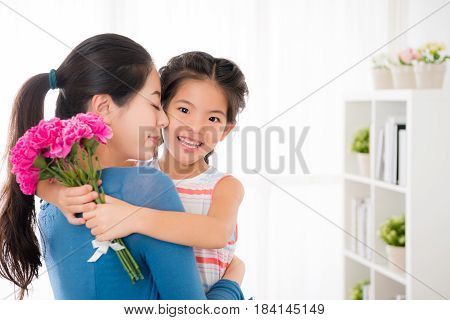 Young Mother Embrace With Smiling Little Girl