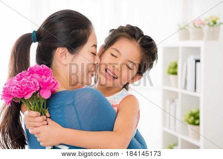 Closeup Of Cute Little Daughter Holding A Bouquet