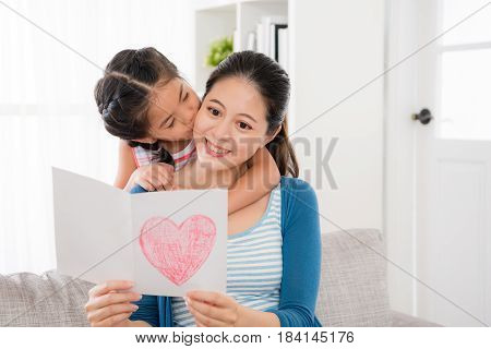 Young Woman Reading The Mother's Day Card Gift