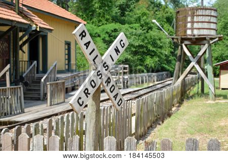 TIFTON, GA - APR 29, 2017 A railroad crossing sign lets pedestrians at the Georgia Museum of Agriculture and Historic Village know they are nearing the train depot, where an old steam engine train operates as part of the historic attraction.