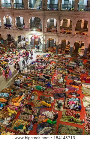 Amritsar, India - March 29, 2016: Unidentified indian people sleeping on the floor in the pilgrim's dormitories of the Sikh Golden Temple in Amritsar, India