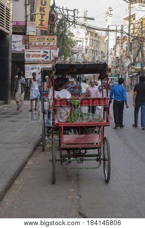 DELHI INDIA - JUN 7 : rickshaw in front of chawri bazar metro station in old Delhi of Delhi on june 7 2015 india. rickshaw is three wheeler taxi for local area of Delhi
