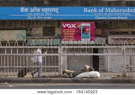 DELHI INDIA - JUN 10 : tramp man sleep on street in morning at chandni chowk in old delhi of Delhi on june 10 2015 india