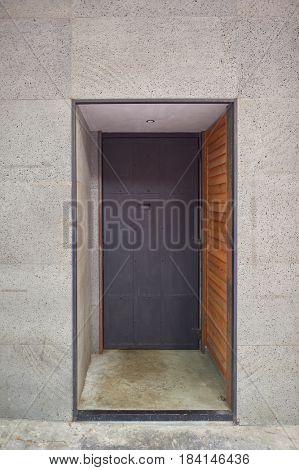 Heavy black door