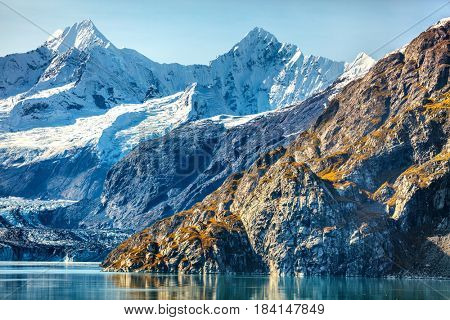 Alaska nature travel. Glacier Bay National Park, Alaska, USA. Glaciers landscape of alaska mountain peaks and glacier melting in water. View from cruise ship.