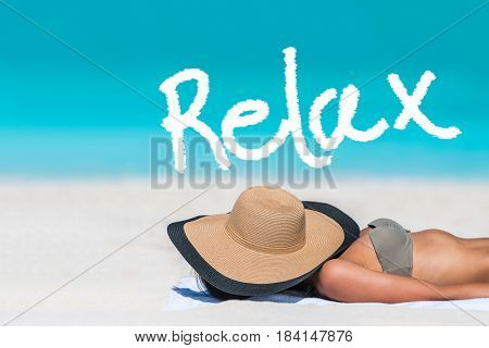 RELAX written on beach background for summer holidays concept. Word above woman tanning lying down sleeping covering her face with hat for uv sun rays protection. Vacation girl relaxing on travel.