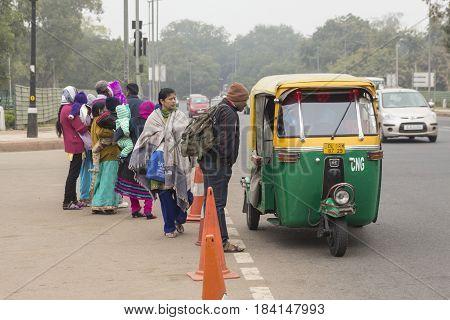DELHI INDIA - DEC 14 : autorickshaw in rajpath in front of India gate. autorickshaw is taxi in delhi on december 14 2014 india