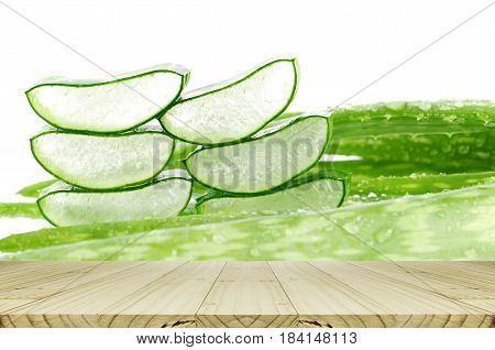 Slice Aloe Vera Leaves Background With Rain Drops And Wood Table.