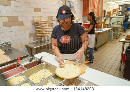 CHICAGO, IL - CIRCA MARCH, 2016: worker at Blaze Pizza restaurant. Blaze Pizza LLC is a Pasadena, California-based chain within the fast-casual dining restaurants category.