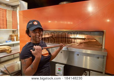CHICAGO, IL - CIRCA MARCH, 2016: indoor portrait of a worker at Blaze Pizza restaurant. Blaze Pizza LLC is a Pasadena, California-based chain within the fast-casual dining restaurants category.