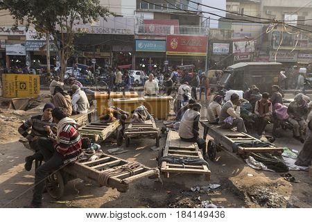 DELHI INDIA - DEC 20 : group of worker rest in chandni chowk at old delhi old delhi is aged and famous place of delhi on december 20 2014 india
