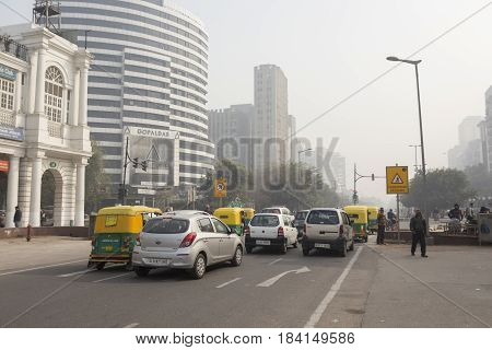 DELHI INDIA-DEC 25 : traffic in connaught place circle . this place is large shopping place in central delhi on december 25 2014 india