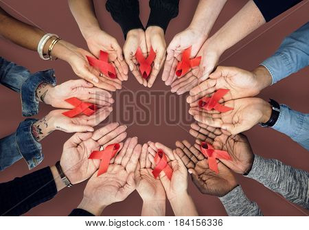 Hands holding red ribbon for HIV and AIDS awareness