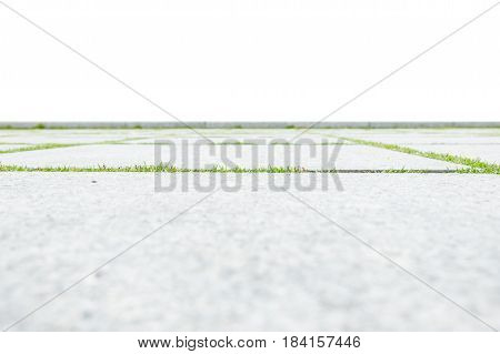 low angle view of concrete floor with green grass isolated on white background.