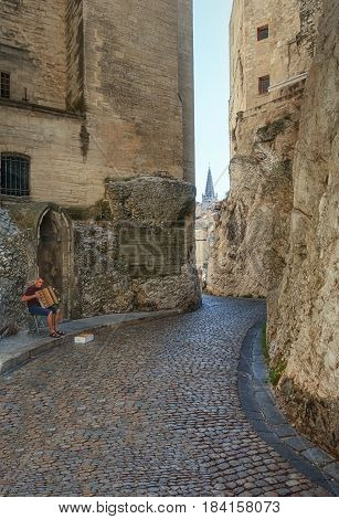 Avignon, France, September 9, 2016: Accordion player in the narrow streets around the Papal palace in Avignon France