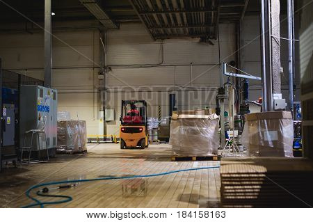 Warehouse Employee In Overalls Clothes, Driver Reachtruck Busy Working On Logistics Moving On Loader