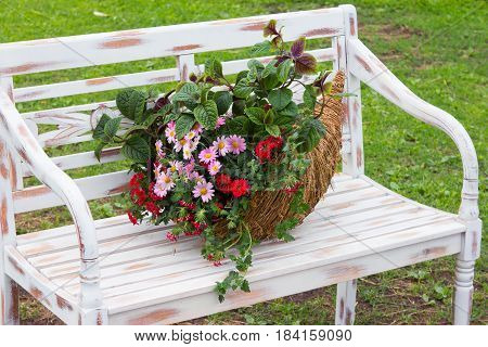 A Romantic Arrangement With A Cornucopia Filled With Flowers.
