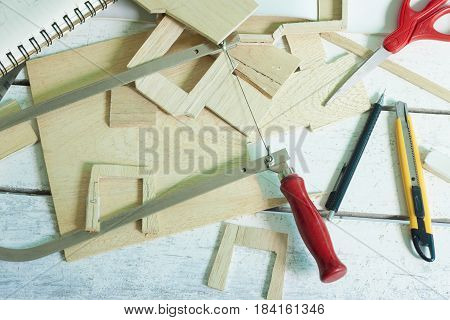 Cutters, scissors, wood sticks, paper used in cutting wood assembly and crafts.