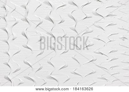 White relief design pattern, smooth stucco structure background with free space for text. Creamy texture creative backdrop.
