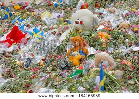STOCKHOLM SWEDEN - APR 17 2017: Flowers Teddy bears from people paying respect to the victims in the terror attack in Stockholm April 07 2017. April 17 2017 in Stockholm Sweden
