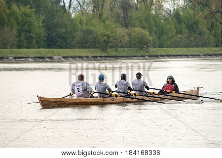 Neuoetting,Germany-April 29,2017: A scull participating at the Inn-Beaver regatta from Neuoetting to Muehldorf rows towards the start line during rain showers in Neuoetting