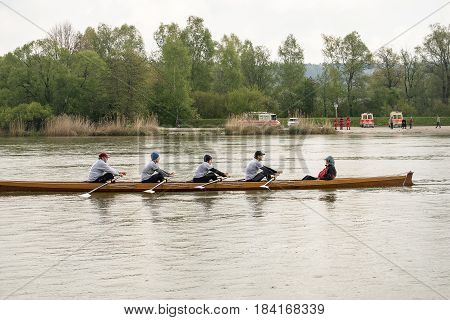 Neuoetting,Germany-April 29,2017: The coxswain in a scull participating at the Inn-Beaver regatta from Neuoetting to Muehldorf enjoys briefly the scenery after crossing the start line