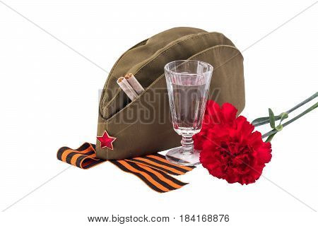 Military cap with red flowers and a star concept isolated on white