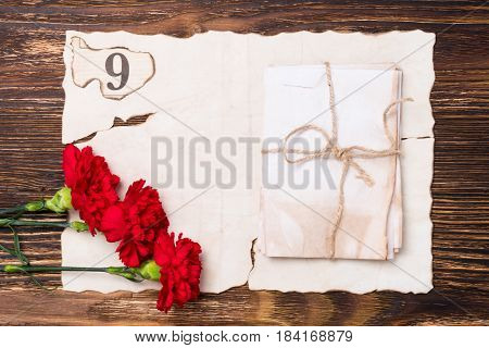 beautiful greeting card on may 9 the red flowers on the table on old paper