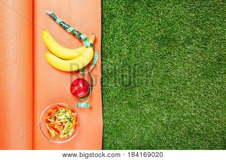 set of sports nutrition on the Mat concept on green grass