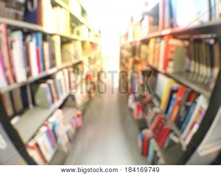 Blurred Abstract Background View Of Book Shelves Aisle In University Library: Blurry Image Of Interi