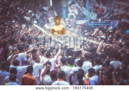 NONGKHAI THAILAND APRIL 13: Songkran Festival The people pour water and join parade of the statue of Luang Pho Phra Sai with respect to faith on April 13-18 2017 in Nongkhai Thailand.