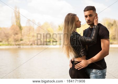 Young couple taking a walk in the park. In love and relationship. Happines and love