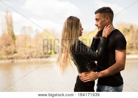Happy couple embracing each other in the park In love and relationship. Happines and love