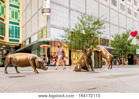 Adelaide Australia - April 05 2017: Four famous Rundle Mall Pigs after restoration and repavement in Adelaide CBD on a day. This sculptures attract a lot of tourists of all ages