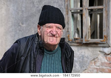 VELIKO TARNOVO BULGARIA - MARCH 18 2017: Portrait of old man in the street