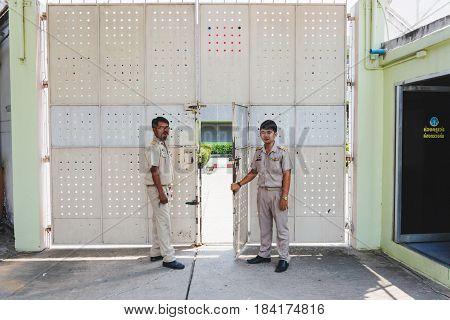 Nakhonsawan Thailand 5 Apirl 2017: prison guard warden in uniform. Standing and opening the dept of corrections Juvenile Detention center's gate.