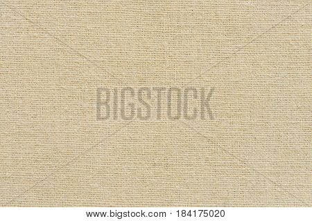 Hessian sackcloth woven texture pattern background in yellow beige cream brown color tone: Eco friendly raw organic flax cloth fabric textile backdrop: Bag rope thread detailed textured burlap canvas