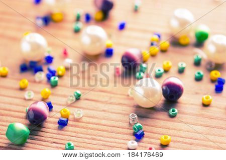 Colorfuld Beads On Wooden Table