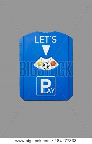 A german parking disc with the words Let`s and Play and sports balls, isolated on grey