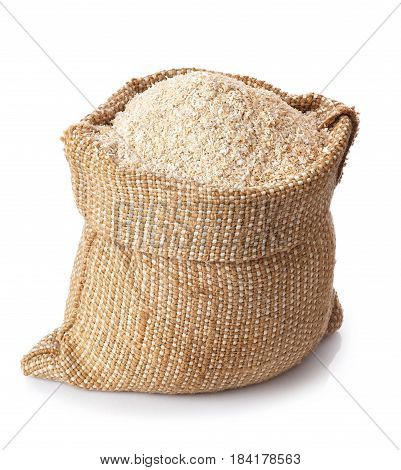 bran in burlap bag isolated on white background. Food supplement to improve digestion. Dietary fiber. Product for healthy nutrition and diet