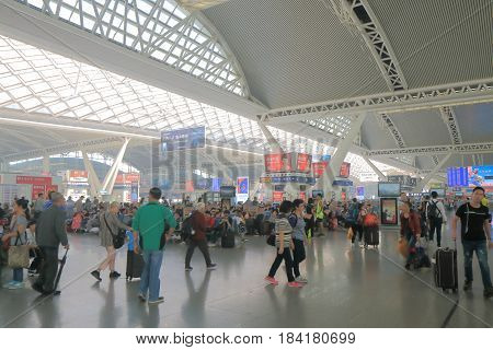 GUANGZHOU CHINA - NOVEMBER 15, 2016: Unidentified people travel at Guangzhou South train station.