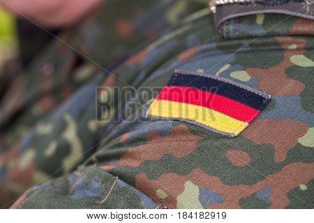 a german flag on german army uniform