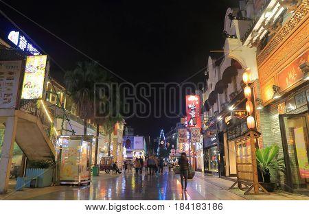 GUILIN CHINA - NOVEMBER 15, 2016: Unidentified people visit Zhengyang shopping street night market. Zhengyang street is a main shopping pedestrian street.