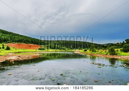The view from the bridge over the river Usva on a cloudy day. Russia Ural Perm Krai