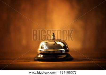 Hotel reception bell service bell on the table selective focus