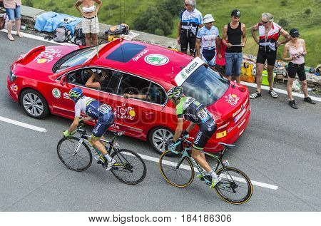 Col de PeyresourdeFrance- July 23 2014: Two cyclists Maarten Wynants of Belkin Team and Michael Albasini of Orica GreenEDGE Team climbing the road to Col de Peyresourde in Pyrenees Mountains during the stage 17 of Le Tour de France on 23 July 2014.