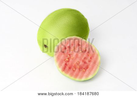 Halves pink guava isolated on white background