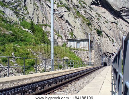 old railway and tunnel perspective in Switzerland