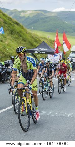 Col de PeyresourdeFrance- July 23 2014: The Italian cyclist Matteo Tosatto of Tinkoff-Saxo Team riding in the peloton on the road to Col de Peyresourde in Pyrenees Mountains during the stage 17 of Le Tour de France on 23 July 2014.