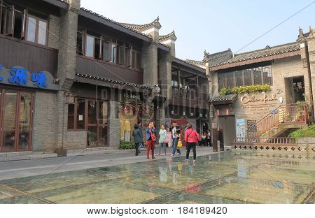 GUILIN CHINA - NOVEMBER 16, 2016: Unidentified people visit East West street. East West street features boutiques fashion galleries traditional teahouses and cafes in folk styles opened in 2016.